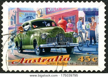 AUSTRALIA - CIRCA 1997: A used postage stamp from Australia depicting an illustration of a GMH Holden 48-215 (FX) 1948 automobile circa 1997.