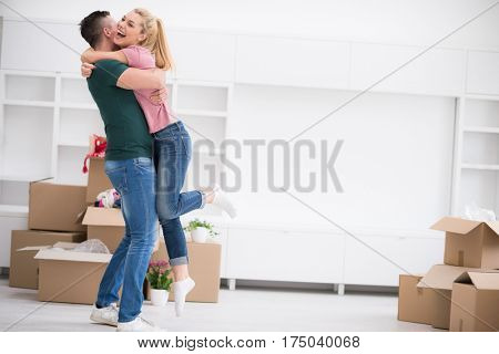 excited happy young couple looking forward to moving into a new home