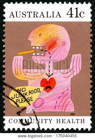 AUSTRALIA - CIRCA 1990: A used postage stamp from Australia promoting a healthy lifestyle by saying No junk Food Please circa 1990.