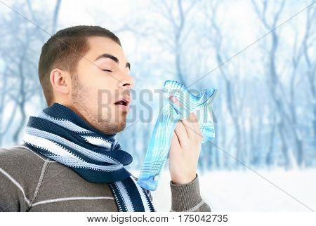 Sick man with handkerchief in winter, outdoor