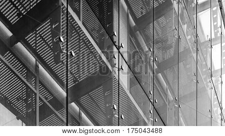 Black and white architecture abstract background. Glass curtain walls. Fasteners elements of spider glass system. Facade detail