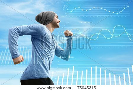 Heart rate monitor concept. Young man running on sky background