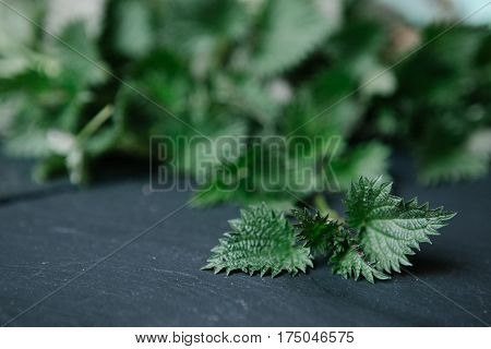 Stinging nettle on a stone cutting board