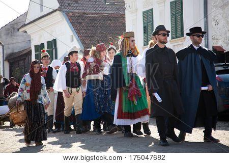 RIMETEA - Romania, March 4, 2017: Local unidentified villagers of Torocko attending the carnival show the celebration at the ending of winter Rimetea, Romania