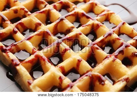 Delicious wafer cells with chocolate syrup, closeup