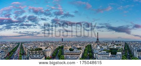 Wide angle skyline of Paris with Champs-Elysees, Montparnasse and Eiffel Towerat sunset