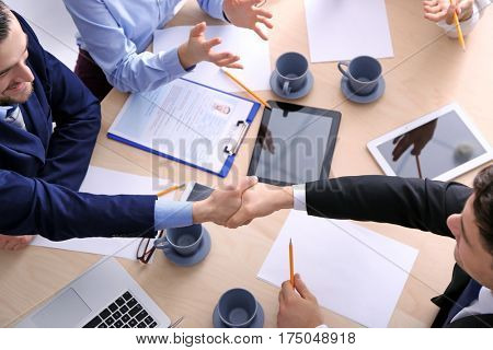 People shaking hands on business interview
