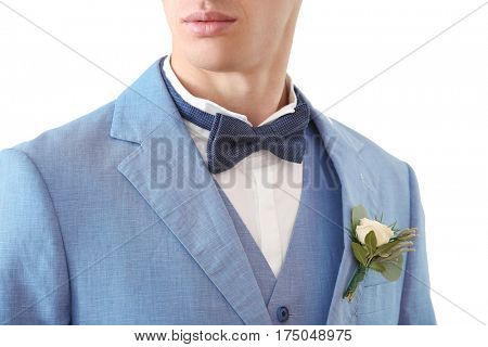 Closeup view of groom with beautiful boutonniere on white background