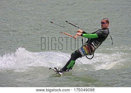 kitesurfer riding his board on flat water