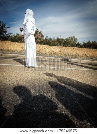 Tourist shadows enjoying easter traditional procession in bercianos de aliste brotherhood, zamora, Spain