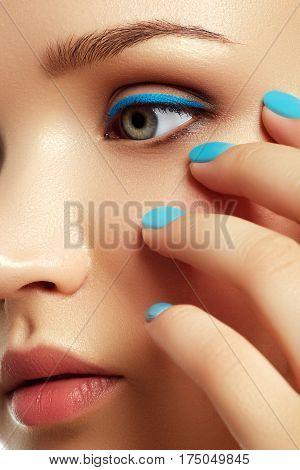 Woman's Face With Vivid Make-up And Colorful Nail Polish