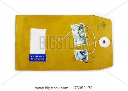 Used paper envelope with postage stamps and free space for text on white background