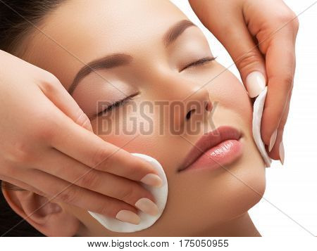 Portrait Of Happy Smiling Beautiful Young Woman Cleaning Skin By Cotton Pad