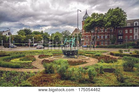 HELSINGOR DENMARK 14 JUNE: Cityscape of park and fountain with dancing girls Helsingor Denmark in 2012