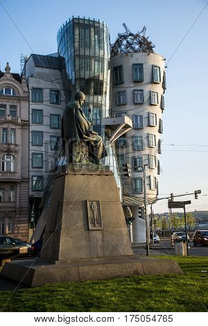 Dancing House and monument of Alois Jirasek in Prague Prague, Czech Republic
