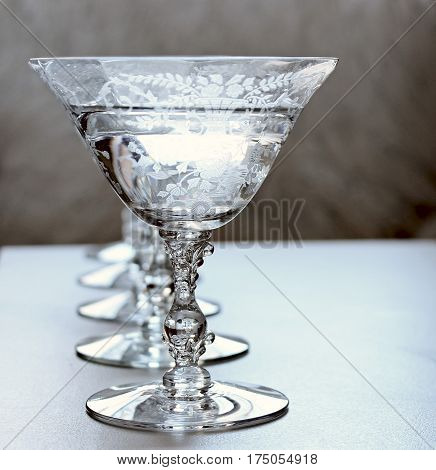 Ornate vintage stemware filled with champagne in a row