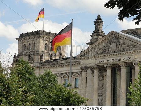 Reichstag Building in Berlin, Germany with Flags