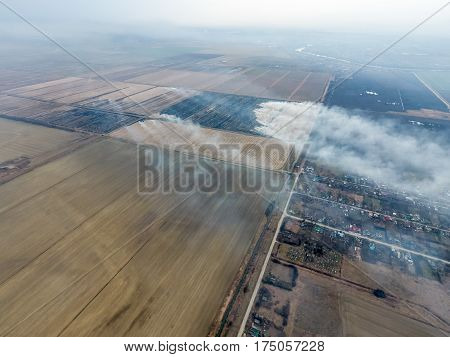 Top View Of The Small Village. Smoke From The Burning Of Straw I
