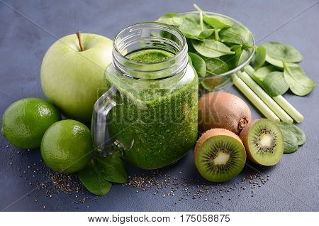 Healthy green smoothie with kiwi, apple, spinach and chia seeds, selective focus