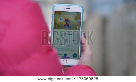 Samara, Russia - March 7, 2017: woman playing pokemon go on his iphone 6s Plus. pokemon go multiplayer game with elements of augmented reality. Porygon2 was caught. Second generation of Pokemon