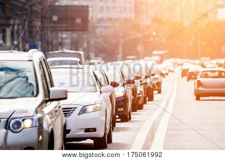 Congested lane with queue of cars at sunset