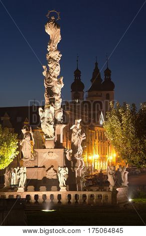 Nightly view of Plague Column on the main square of Telc or Teltsch town