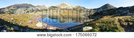 Morning panoramic mountain view from romanian Carpathian mountains Bucura lake and Retezat mountains Romania