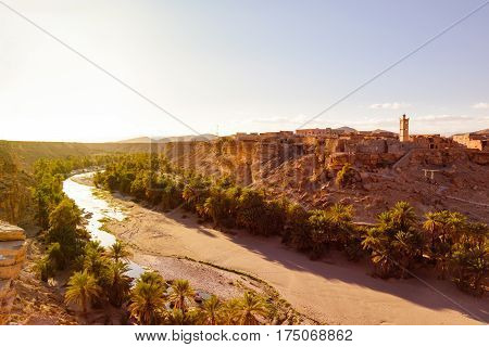 Beautiful image of the small village Trit near Tata with a Oasis of Palms and the Oued Tissint in Morocco.