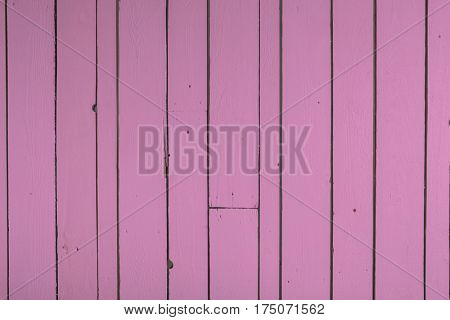 Pink reclaimed timber wall backgound