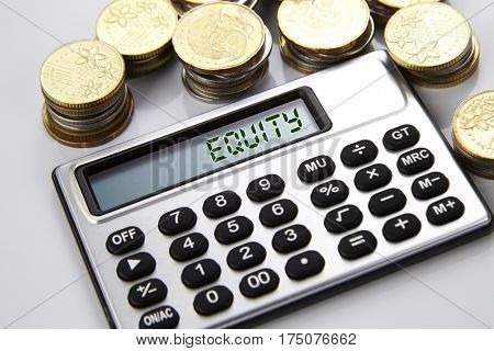 few stacks of coins and calculator with text on screen equity