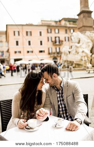 Loving Couple Drinking Coffee In Rome, Italy