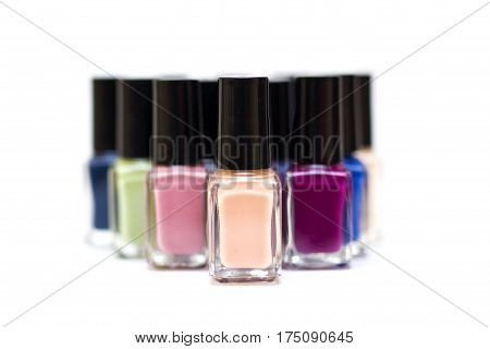 Coloured Nail Polish Bottles On A White Background