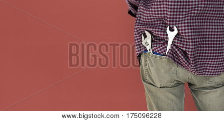 Man Wrench Tools Plaid Shirt Jeans Studio