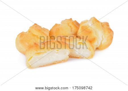 eclair or cream puffs with vanilla custard on white background