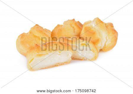 eclair or cream puffs with vanilla custard on white background