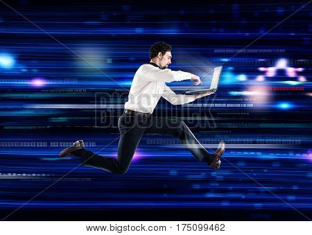 Futuristic technology background with a businessman who runs with laptop. Global internet connection and streaming concept
