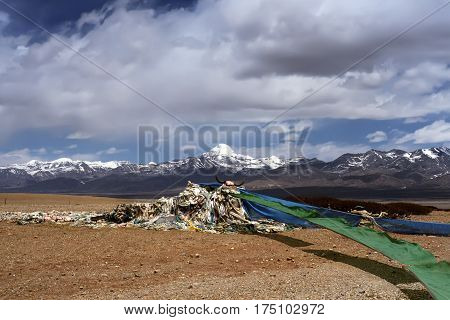 Tibetan prayer flags flutter on the wind at the view point of Sacred Mount Kailash in Barga Valley, Western Tibet.