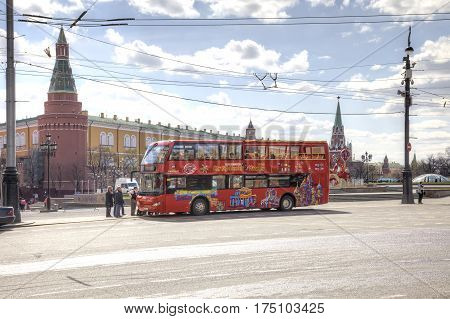 MOSCOW RUSSIA - April 24.2016: Red sightseeing bus stopped at the Theatrical Square in anticipation of tourists