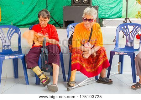 CHIANG RAI THAILAND - FEBRUARY 19 : Unidentified old asian women suffering from leprosy sitting in Christian camp on February 19 2016 in Chiang rai Thailand.