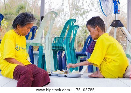 CHIANG RAI THAILAND - FEBRUARY 19 : Unidentified old asian women suffering from leprosy eating food on February 19 2016 in Chiang rai Thailand.