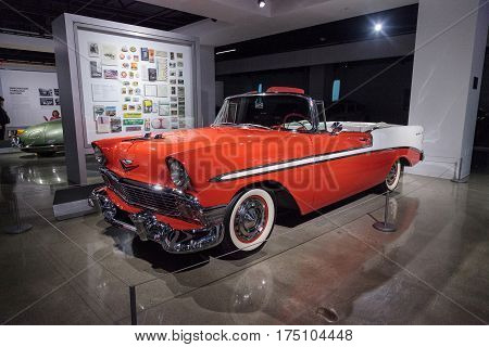 Los Angeles CA USA -- March 4 2017: Orange 1956 Chevrolet Bel Air Convertible from the collection of Chris and Don Meyers at the Petersen Automotive Museum in Los Angeles California United States. Editorial only.