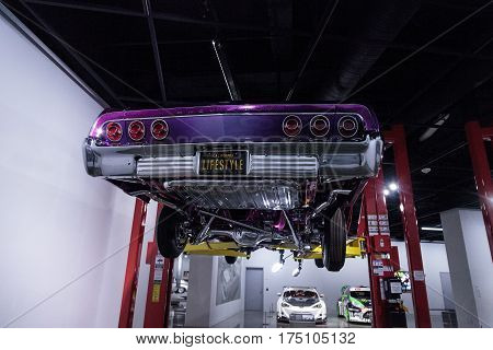 Los Angeles CA USA -- March 4 2017: Purple and pink 1964 Chevrolet Impala called Sinful Sin at the Petersen Automotive Museum in Los Angeles California United States. Editorial only.