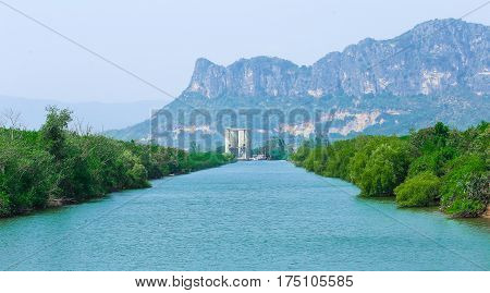 Mountain river on green forest and mountains background in summer, landscape