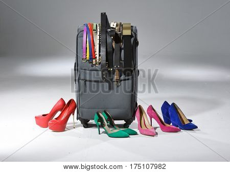 Luggage and many hat and belt ,shoes isolated on light background