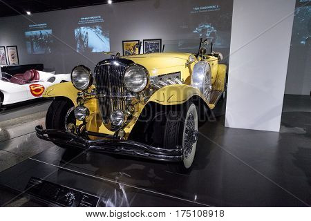 Los Angeles CA USA - March 4 2017: Yellow 1984 Duesenberg II SJ driven in the move The Great Gatsby at the Petersen Automotive Museum in Los Angeles California United States. Editorial only.