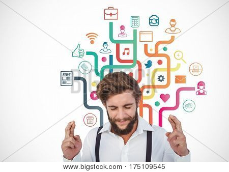 Digital composite image of man keeping finger crossed and application icons at bacground