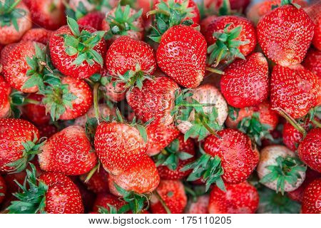 Strawberries. Background from fresh strawberries, Red strawberries. Strawberries at market. Strawberries fruits. Healthy strawberries