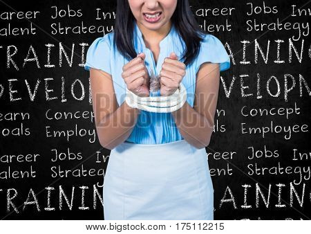 Digital composite image of businesswoman tied up with rope against blackboard