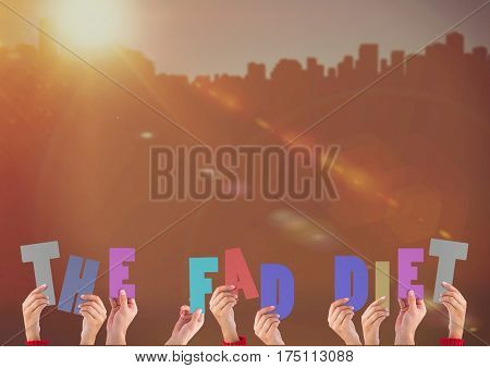 Hands holding word The Fad Diet against bright sunlight