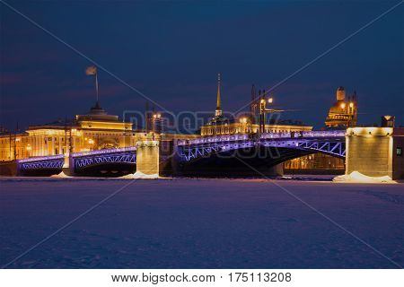 Palace Bridge against the background of the Admiralty in the February evening. Winter St. Petersburg, Russia